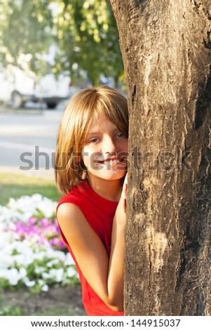 hidden behind the tree - stock photo