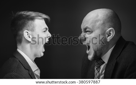 ?hief and his subordinate shouting at each other - stock photo