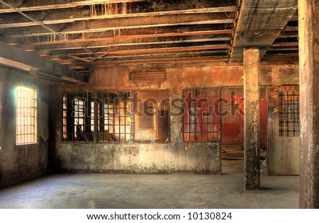 High Dynamic Range Image of a Burned Out Cell Block of an Abandoned Penitentiary - stock photo