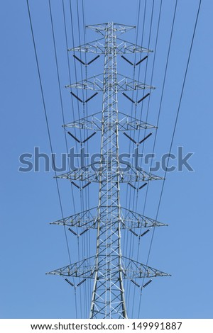 High voltage power and power line with blue sky - stock photo