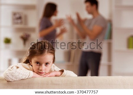 Ð¡hild suffering from quarrels between parents in the family at home - stock photo