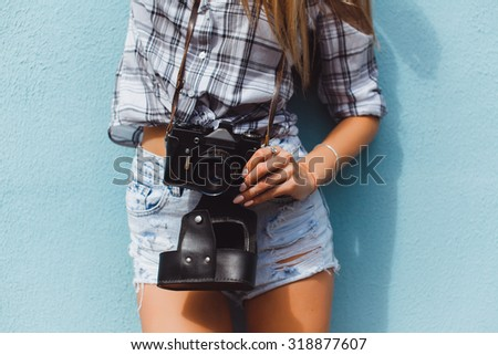 Hipster traveler photographer girl taking picture on professional camera, bright colors.Tone.denim outfit, flirty cool vintage style, having fun, sitting, stairs, old school film , photo, flirty, - stock photo