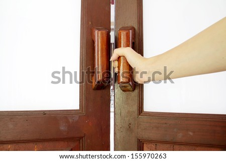 hold handle of wood door - stock photo