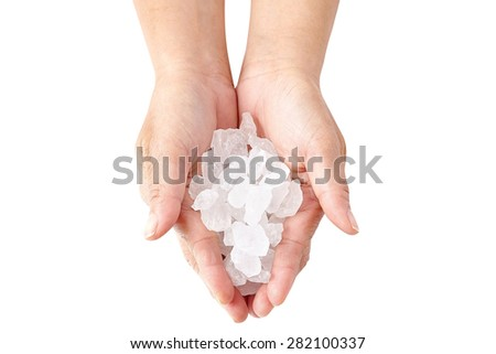 holding rock candy isolated on white background - stock photo