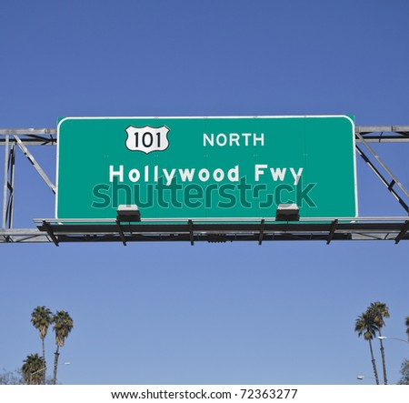 101 Hollywood Freeway sign with tall palm trees. - stock photo