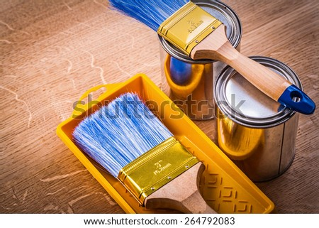 horizontal version paint can brushes tray on wooden board construction concept - stock photo