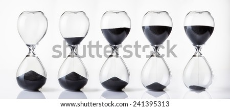 hour glass sand timer running out - stock photo