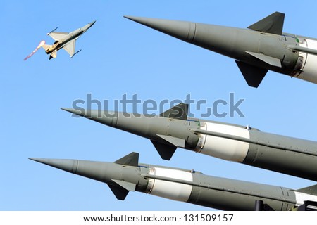 3 hq S-125  ground to air missile ready to attack fighter airplane - stock photo