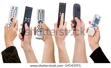 human hands from a remote control on a white background.control panel. - stock photo