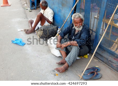 HYDERABAD,INDIA-MAY 20:Senior homeless poor Indian men seeking help or alms at the entrance of Bhagyalaxmi temple, Charminar  on May 20,2016 in Hyderabad,India.                              - stock photo