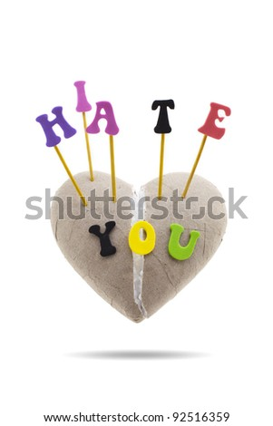 'I Hate You' spelled out with letters on broken heart made of paper, isolated on white background - stock photo