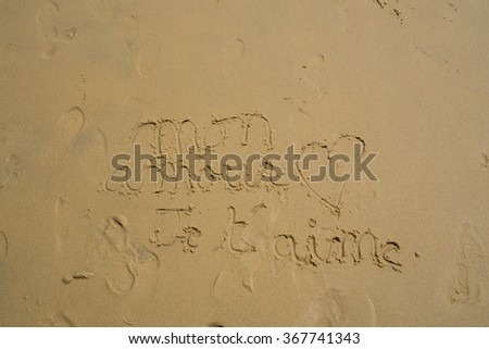 """""""I love you, my love"""" in french (Mon amour, Je t'aime) written in sand on the beach in France - stock photo"""