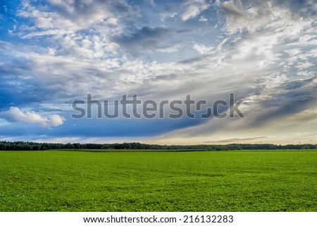 Idyllic landscape with blue sky and clouds - stock photo