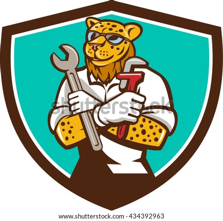 `Illustration of a leopard mechanic holding spanner and monkey wrench with arms crossed viewed from front set inside shield crest on isolated background done in cartoon style.  - stock photo