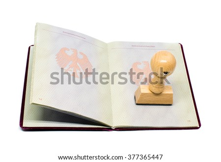 Immigration approved -German passport with stamp and shadow on a perfect white background - stock photo