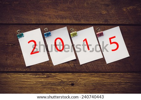 2015 in paper note on wooden background - stock photo