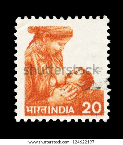 INDIA - CIRCA 1984: A stamp printed in India shows image of a woman breastfeeding her child, series, circa 1984 - stock photo