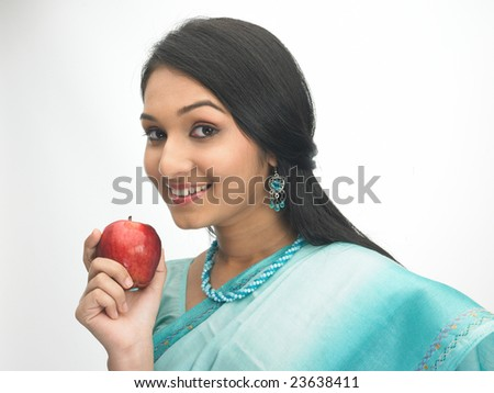 indian girl with the red apple - stock photo