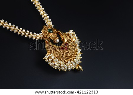 Indian Traditional Gold Necklace with Pearl  - stock photo