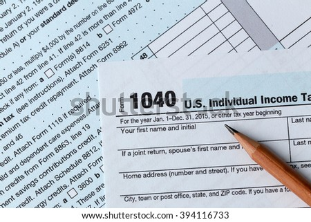 1040 Individual Income Tax Return Form for 2015 year with a pencil to fill in, close up - stock photo