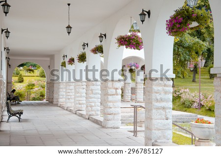 indoor of building. Fantastic background. - A long passage between many old columns - stock photo