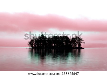 infrared landscape with alone small island on calm lake for background or poster - stock photo