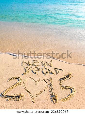2015 inscription on the sand near the sea.  - stock photo