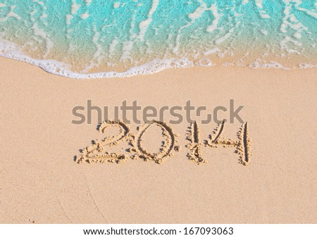 2014 inscription on the sand near the sea. Summer Vacation by the Sea 2014! - stock photo