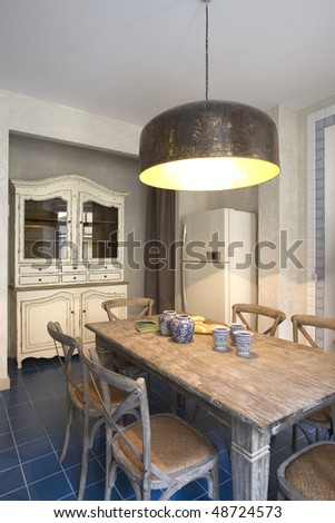 interior of a kitchen with big lamp, window and food on the table - stock photo