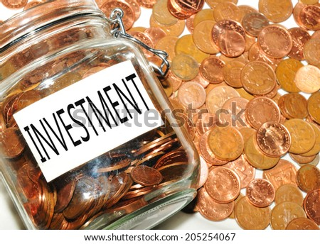 Investments concepts with jar of money and coins - stock photo