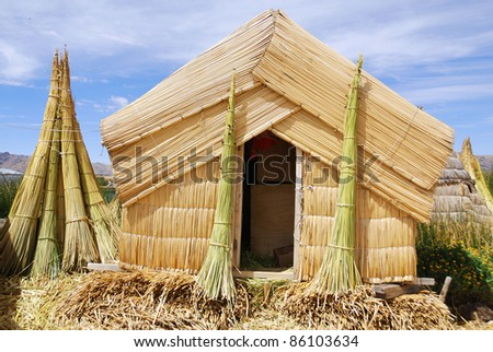 Islets are made of totora reeds, which grow in the lake. The dense root that the plants develop and interweave form a natural layer called Khili about one to two meters thick that support the islands - stock photo