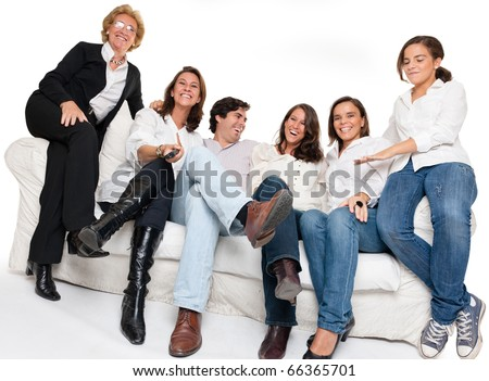 Isolated happy family sitting on a sofa watching TV - stock photo
