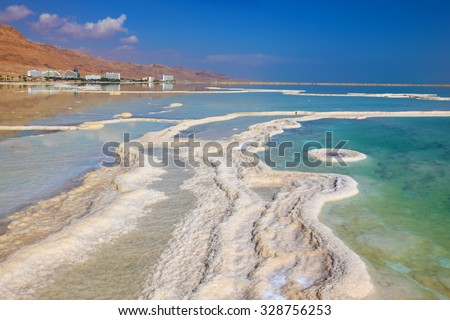 Israel in October. The patterns evaporated salt in the Dead Sea. Salt formed a long track with scalloped edges. - stock photo