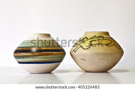 Israeli ceramic pair in retro style of 1950-th years. Abstract and drawing images, pastel tones.Symbolizes couple: He and She; brother and sister etc. Isolated on white. - stock photo