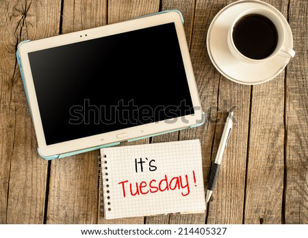 """It""""s Tuesday. Tablet PC, cup of coffee on wooden background,Its Tuesday text on small notepad - stock photo"""