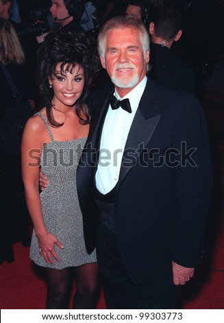 10JAN99:  Country singer KENNY ROGERS & wife at the 25th Annual People's Choice Awards in Pasadena, California.   Paul Smith / Featureflash - stock photo