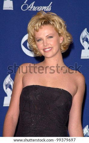 09JAN2000:   South African actress CHARLIZE THERON at the 26th Annual People's Choice Awards in Pasadena, CA.  Paul Smith / Featureflash - stock photo