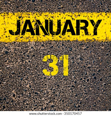 31 January calendar day written over road marking yellow paint line - stock photo