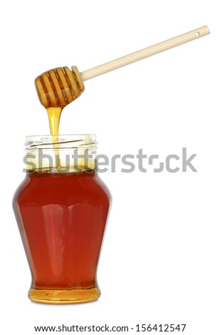 jar of honey with wooden dripper on white - stock photo