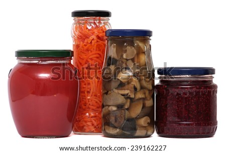 Jars of pickles isolated on white background. Mushrooms, carrots, jam, tomatoes. - stock photo