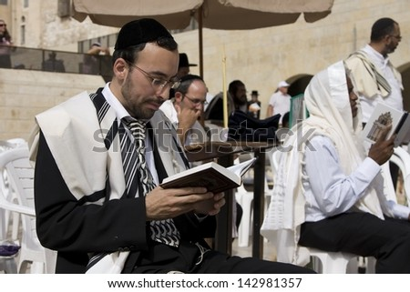 JERUSALEM-October 02: The Jews in prayer at the Western Wall during Jewish holiday of Sukkot, October 2, 2012 in Jerusalem, Israel. - stock photo