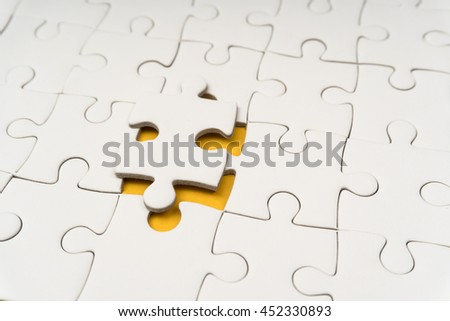 jigsaw puzzle near to completed - stock photo