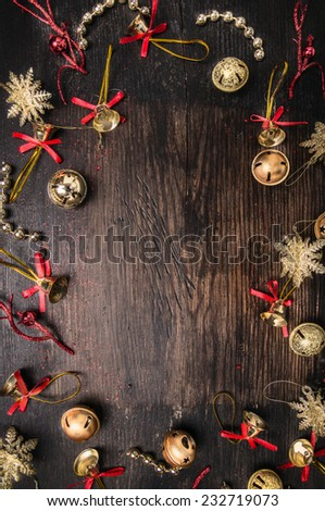 jingle Bells and  decorations on dark wooden, christmas background - stock photo