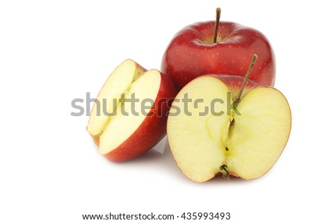jonagold apple and  two halves on a white background - stock photo