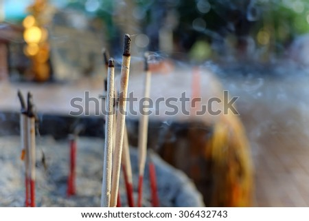 joss stick with blur backgrounds - stock photo