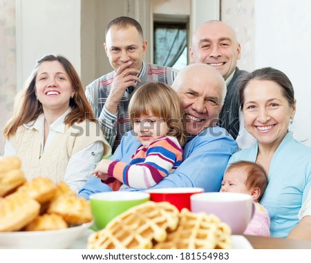 joyful three generations family sits a in home - stock photo