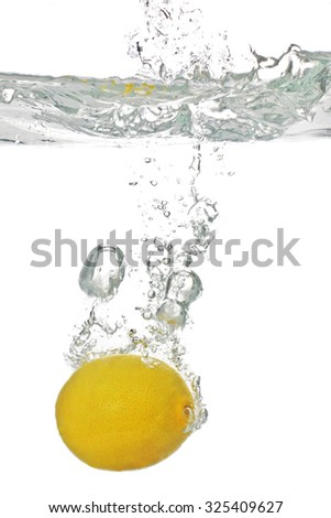 juicy lemon falls into the water