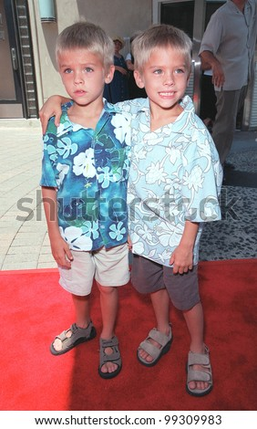 "11JUL99:  Actor twins COLE & DYLAN SPROUSE, stars of new movie ""Big Daddy"", arriving at Sony Pictures Studios in Culver City for the world premiere of ""Muppets From Space"".  Paul Smith / Featureflash - stock photo"