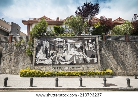13 JUNE 2014 - GUERNICA, Spain. Copy of the painting called 'Guernica' of the famous spanish painter Pablo Picasso in the Guernica city. - stock photo