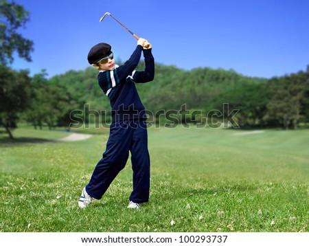 Junior golf swing - stock photo